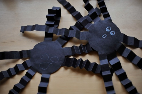 i used black construction paper cut into a circle for the body fan folded strips of black paper for the legs and used a - Halloween Crafts Construction Paper